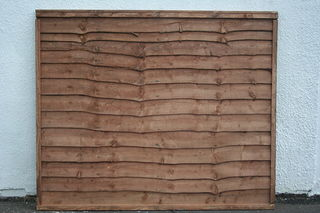 Photography of Waney-Lap Treated Timber FENCE PANEL